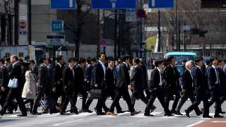 Japan workers pay cut for taking lunch 3 minutes early