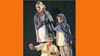 बाल भगत या नाटकात अभिनय करताना सम्यक गजभिये (मध्यभागी बसलेला).