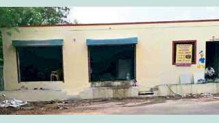 दिघी - विकास आराखड्यातील प्राथमिक शाळेच्या आरक्षणावर बांधलेली दुकाने आणि घरे.