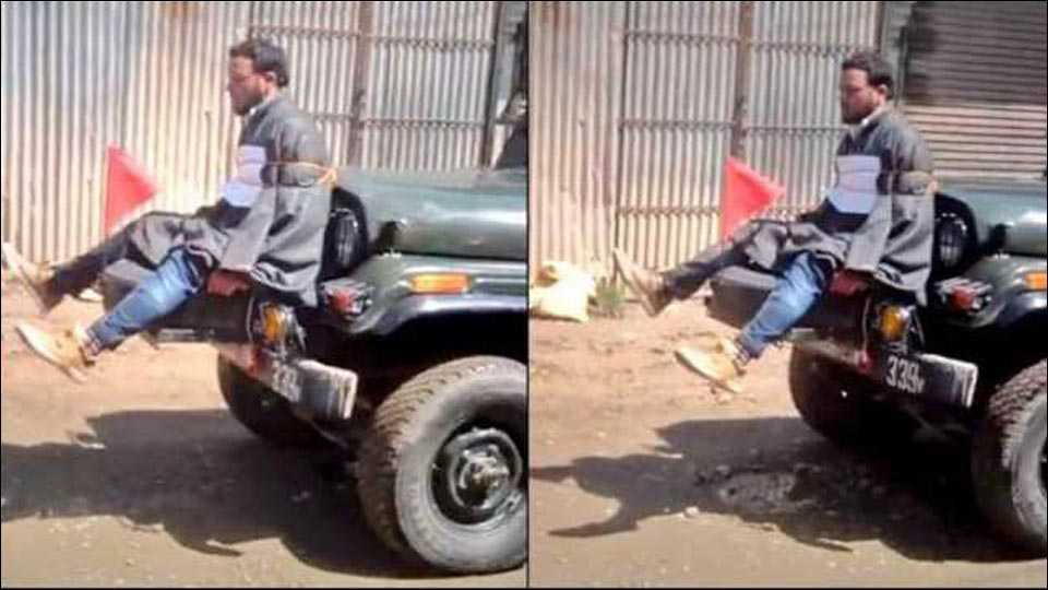 Army tied stone pelter to Jeep