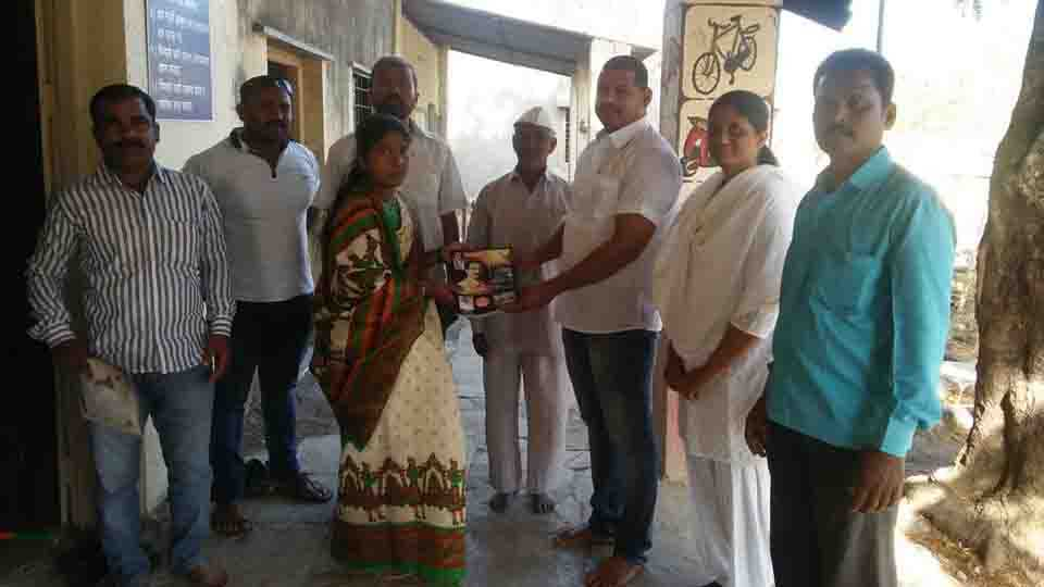 Visit to Ahire Gram Panchayat a set of books on schemes