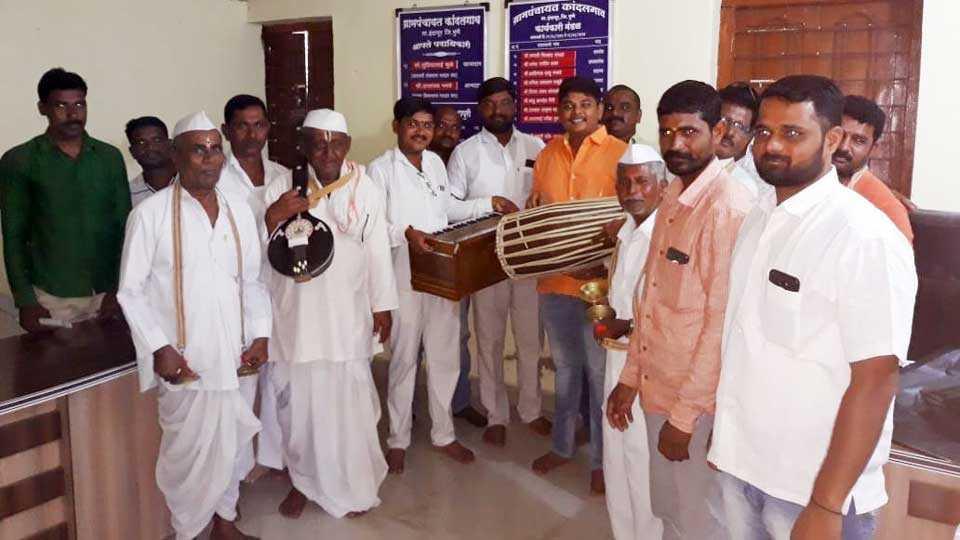 musical equipment distribution to Bhajani Mandal of Kandal gaon
