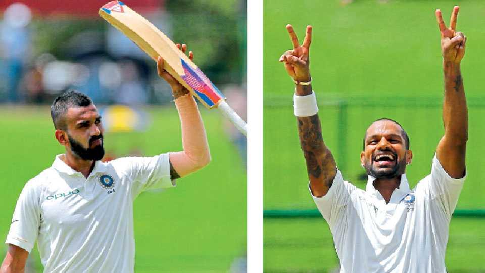 पल्लीकल - के. एल. राहुल अर्धशतकानंतर अभिवादन करताना. तर दुसऱ्या छायाचित्रात श्रीलंकेविरुद्ध तिसऱ्या कसोटी क्रिकेट सामन्यात शतकानंतर ड्रेसिंग रुममधील सहकाऱ्यांना खास शैलीत अभिवादन करताना भारताचा फलंदाज शिखर धवन.