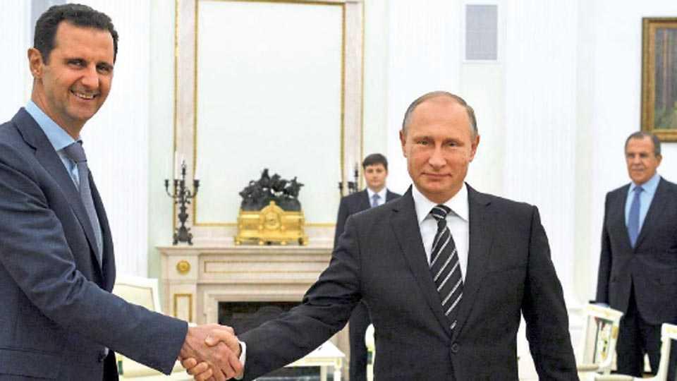 सीरियाचे अध्यक्ष बशर- अल- असद आणि रशियाचे अध्यक्ष व्लादिमीर पुतिन.