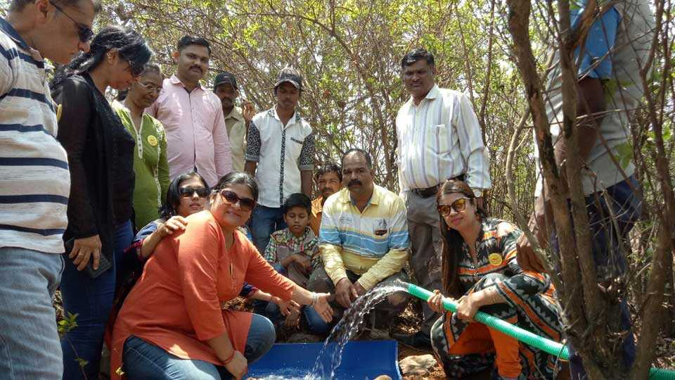 kharghar group creates water storage for animal on hill