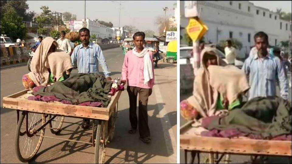 man carries wife's body on handcart for 5 km to reach home