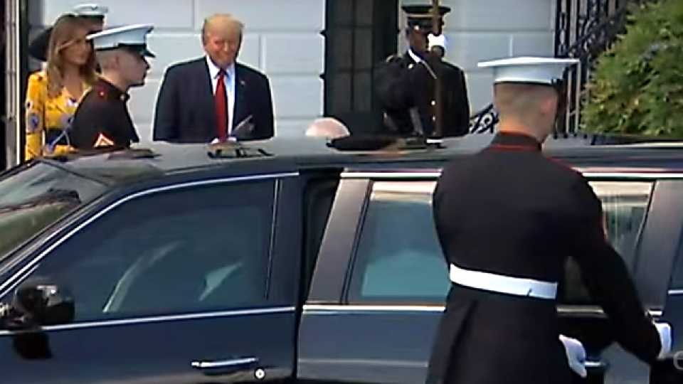 US guard opening the left door of the car expecting Mrs Modi?