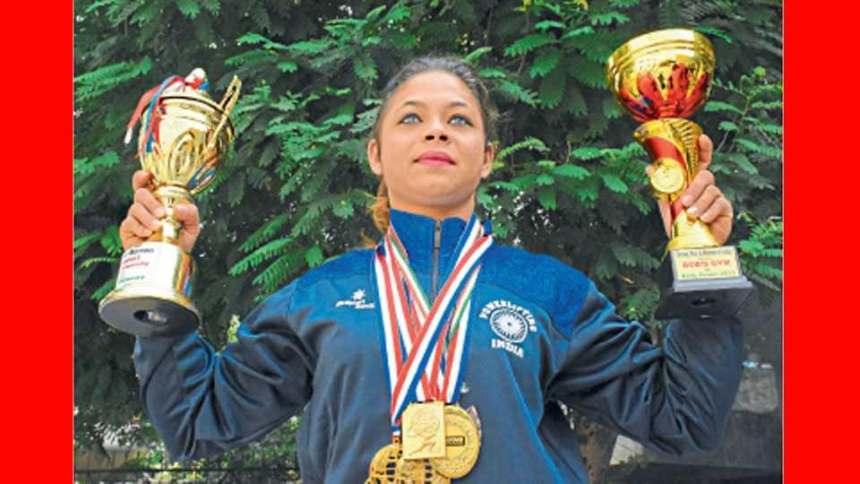 जिंकलेल्या ट्रॉफी व पदकांसह अल्फिया शेख.
