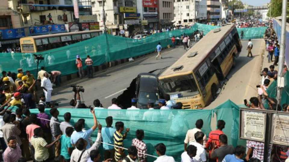 Bus, car trapped as Chennai road caves-in