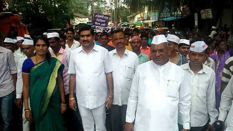 A grand rally of World Tribal Day in murbad