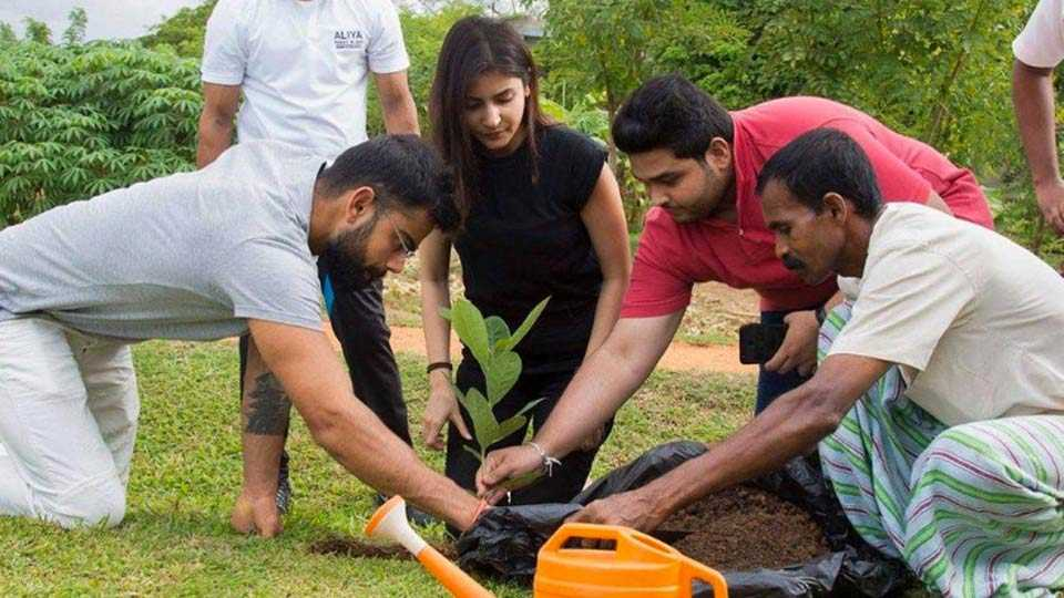 virat kohli and anushka sharma snapped in sri lanka while planting tree