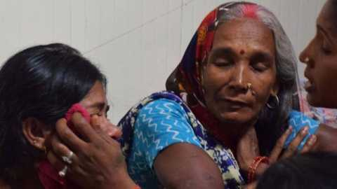 An Indian woman looks after her child at the encephalitis ward of the the Baba Raghav Das Hospital in Gorakhpur